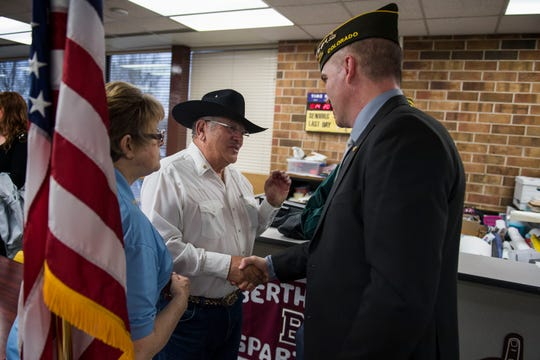 Gabriel Conde's uncle Monse Conde, left, greets VFW commander Ryan Armagost after the chartering ceremony of the new Berthoud VFW Post 12189 - SPC Gabriel Conde Memorial on Tuesday, April 30, 2019, at Berthoud High School in Berthoud, Colo.