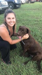 Lehigh Acres resident Daniela Habermehl, an animal-rights advocate, often travels to hurricane-struck cities to rescue stranded and abandoned animals. Here she is with a rescued chocolate lab she helped save from the floodwaters after 2017's Hurricane Harvey struck Beaumont, Texas.