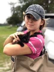 Lehigh Acres resident Daniela Habermehl, an animal-rights advocate, often travels to hurricane-struck cities to rescue stranded and abandoned animals. Here she is in North Carolina with a rescued kitten after Hurricane Florence in 2018.