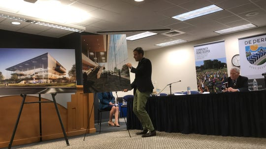 Scott Duncan of the architectural-engineering firm SOM puts up artist's renderings of the proposed Mulva Cultural Center during a presentation Wednesday at De Pere City Hall.