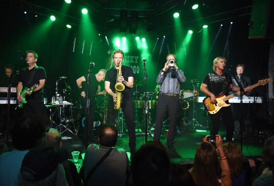 Lou Pardini, left to right, Keith Howland, Walfredo Reyes Jr, James Pankow, Ray Herrmann, Tris Imboden, Lee Loughnane, Jeff Coffey and Robert Lamm of Chicago perform in 2017 in West Hollywood, California.