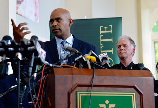Charlotte-Mecklenburg Police Chief Kerr Putney points to a reporter during a news conference Wednesday about the campus shooting at the University of North Carolina Charlotte.