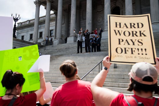 An estimated 10,000 teachers and education supporters participated in a rally outside of the South Carolina statehouse building in Columbia Wednesday, May 1, 2019.