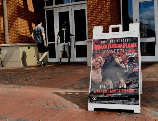 A Waka Flocka Flame concert poster is seen Wednesday, May 1, 2019, the day after a deadly shooting. The April 30 concert at Jerry Richardson football stadium was canceled after the deadly shooting on UNC Charlotte's campus.