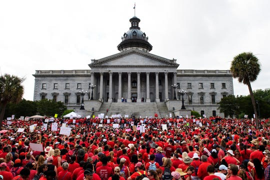 Thousands of teachers participate in a rally in front of the South Carolina Statehouse in Columbia Wednesday, May 1, 2019.