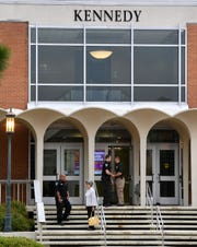 Charlotte-Mecklenburg police guard the the Kennedy building at University of North Carolina Charlotte on Wednesday. A gunman opened fire in a classroom in the building on Tuesday, killing two students and wounding four others.