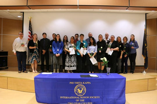 From left: Joshua Archey-Advisor, Shelby Meyers-Advisor, Chad Hooper, Carl Clary, Baily Brumley, Olivia Flamand, Theresa Ground, Shawn Arbuckle, Michele Uhrich, Christopher Disalvatore, Alyssa Beth Luna, Mechele Fonck, Roger Ereaux, Charmaine Engum, Lindsay Wiard-Advisor, Dr. Susan Wolff CEO/Dean and Anya Schendel-PTK Student President pose for a photo after the ceremony.