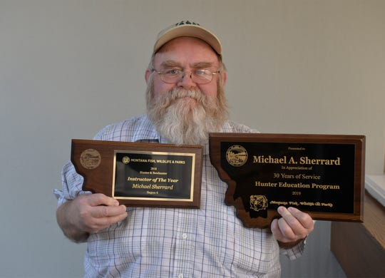 Michael Sherrard with awards from Montana Fish, Wildlife and Parks.  He was awarded instructor of the year for 2018 in Region 4 and was recognized for 30 years of service in the Hunter Education Program.