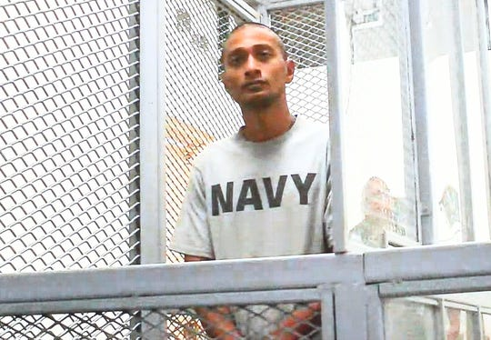 William Garnafngin Yamnang appears via closed circuit video feed for his magistrate hearing at the Guam Judicial Center in Hagåtña on May 1, 2019.
