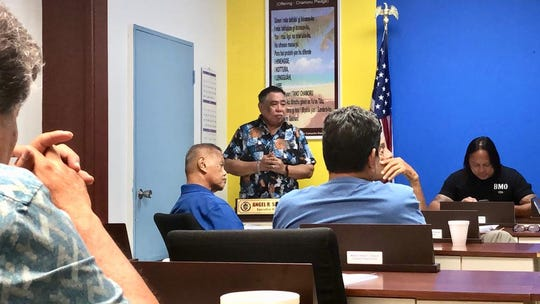 Mayors Council of Guam Executive Director Angel Sablan addresses mayors during a meeting on May 1, 2019.