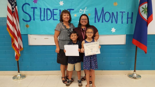 The Guahan Academy Charter School honored its March Student of the Month awardees on April 11. Pictured: Elieau Andoy and Sparrow Lee Concepcion, Teresita Cruz and Jovina Munoz.