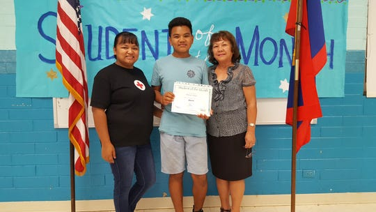 Damian Reyes, Guahan Academy Charter School March Student of the Month on April 11. Pictured: Clarissa Reyes, Damian and Teresita Cruz.