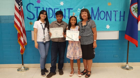 Guahan Academy Charter School March Student of the Month awardees on April 11. Pictured from left; Lara Reyes; Caleb Mesa; Razaiya Quiambao and Teresita Cruz, Dean of High School Guahan Academy Charter School.