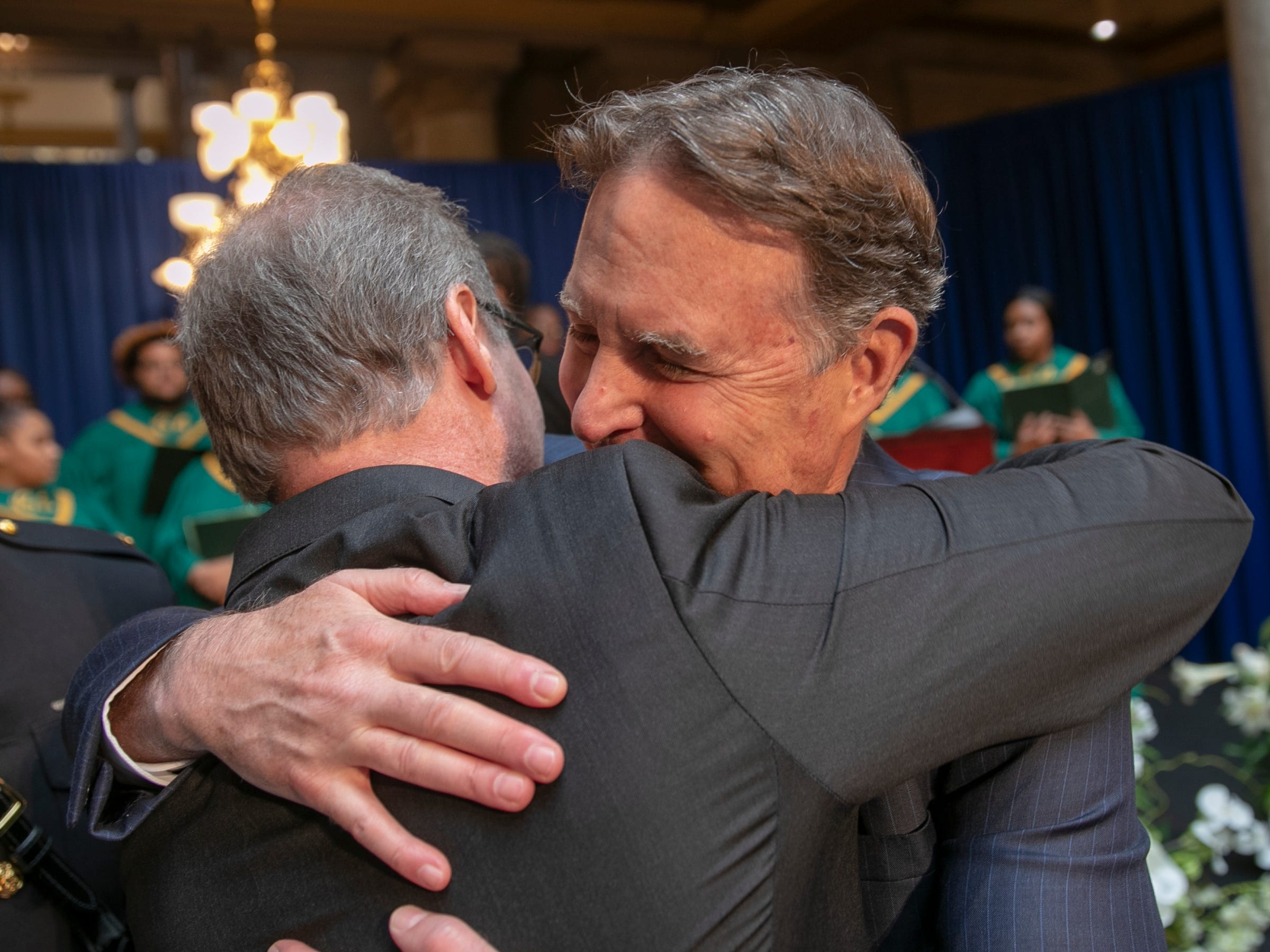 Evan Bayh (right), gets a hug before a service for his father Birch Bayh, who died on March 14, and was a three-term U.S. Senator, Indiana Statehouse, Indianapolis, Wednesday, May 1, 2019.