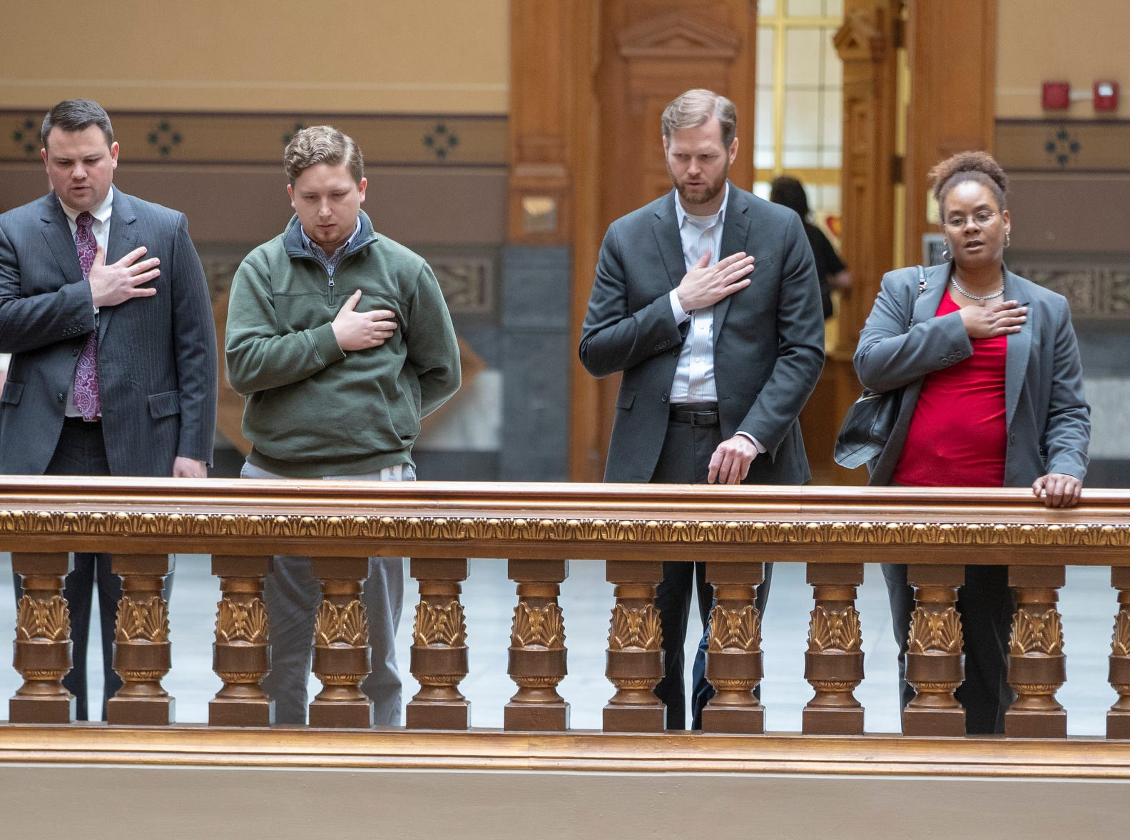 Attendees during the Pledge of Allegiance during a service for Indiana's Birch Bayh, who died on March 14, and was a three-term U.S. Senator, Indiana Statehouse, Indianapolis, Wednesday, May 1, 2019.