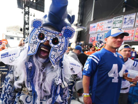 A Colts fan celebrates prior to the start of the 2019 NFL Draft in downtown Nashville, Tennessee.