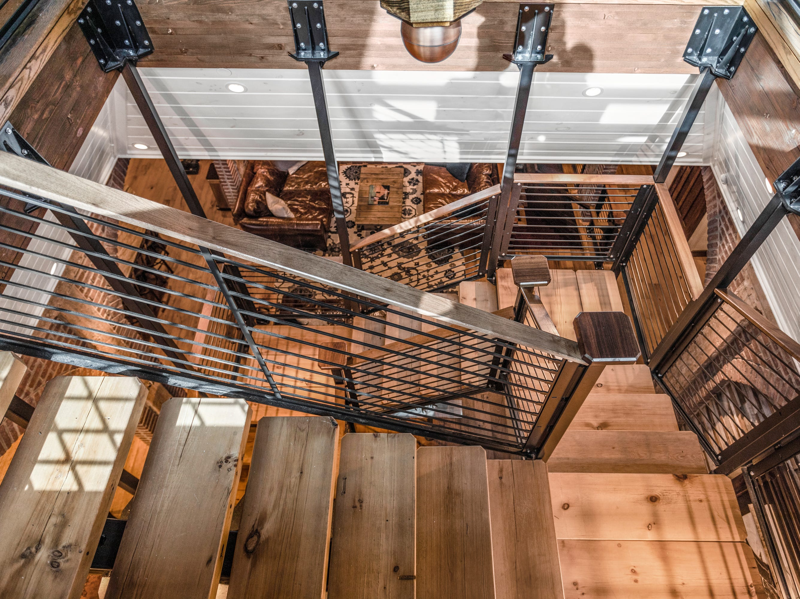 The current owners created this staircase between the two residential floors.
