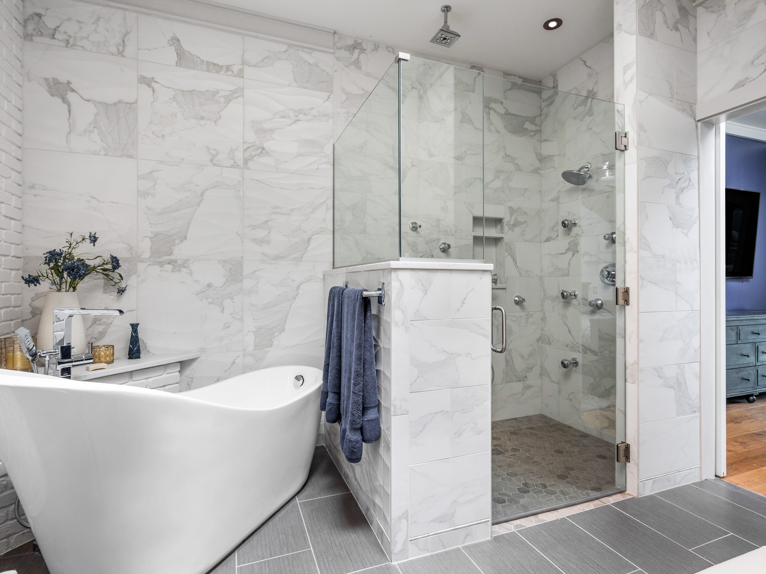 The owners kept the extra-tall shower in the bath, that when the residence was a hotel made it a favorite place to stay for Shaquille O'Neal.