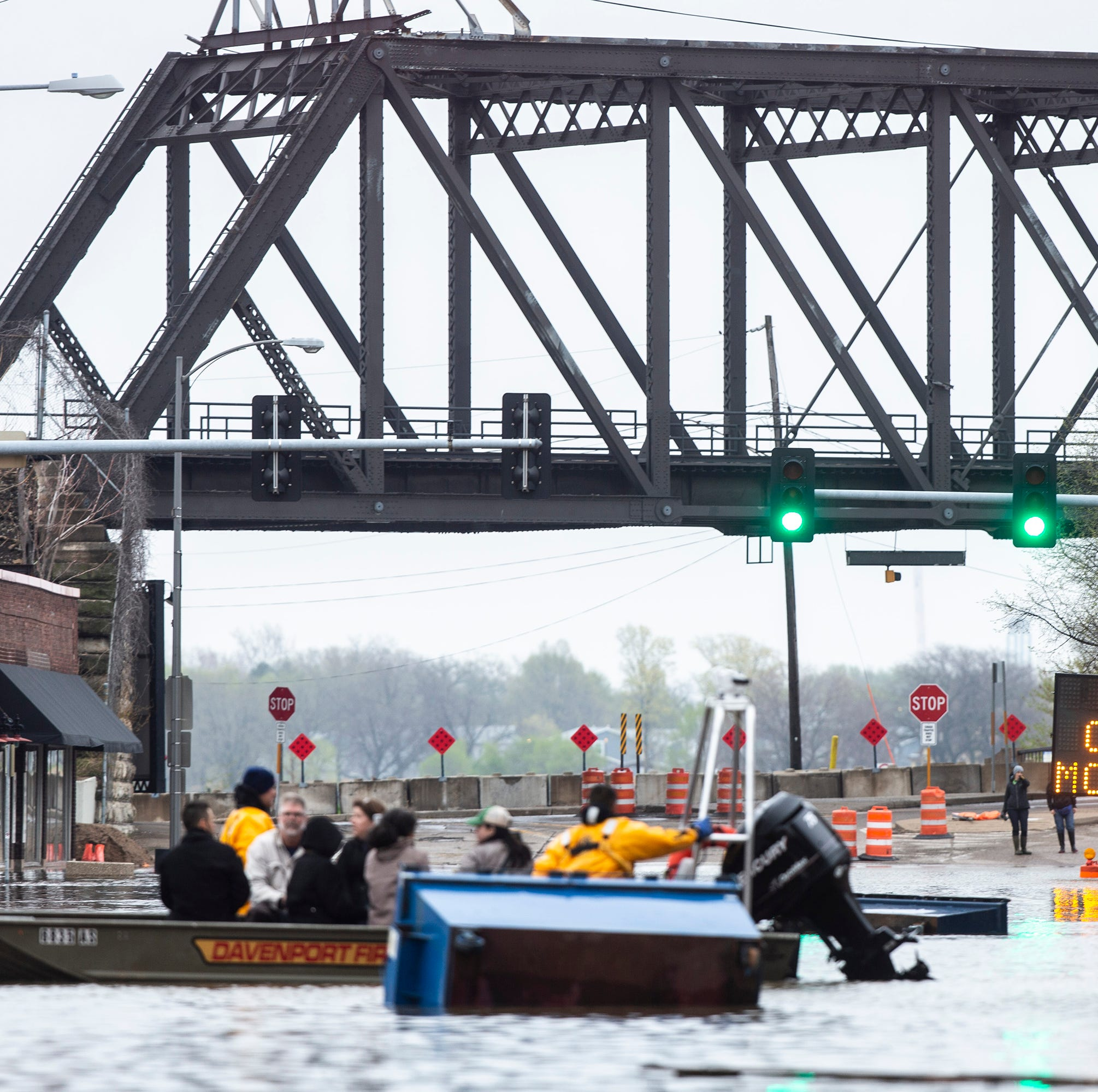 Temporary barrier fails in Davenport, and the Mississippi River floods downtown in Iowa's 3rd-largest city
