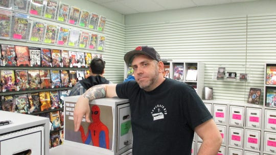 Daydreams Comics owner Zach Power prepares for Free Comic Book Day.