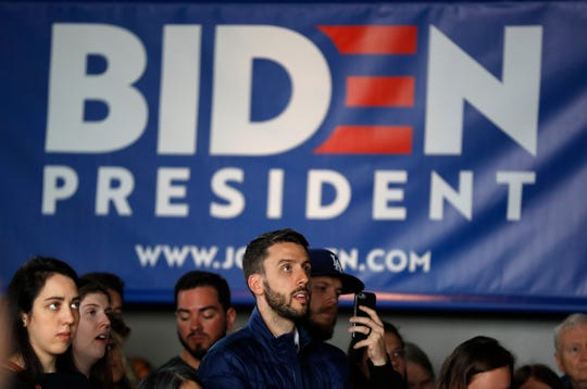 Audience members listen to former Vice President and Democratic presidential candidate Joe Biden speak during a rally, Wednesday, May 1, 2019, in Iowa City, Iowa.