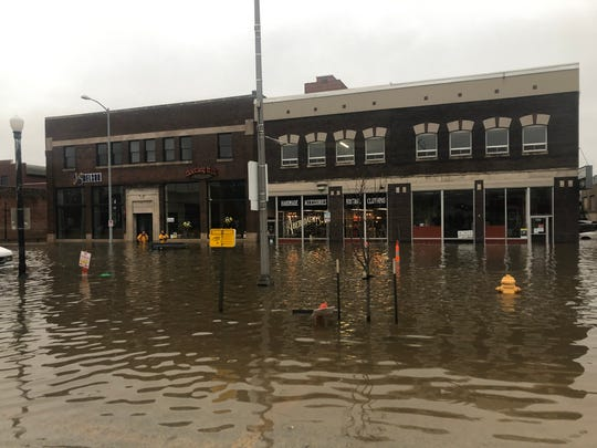 Downtown Davenport businesses are surrounded by floodwater Tuesday afternoon, April 30, 2019.