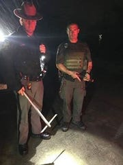 Trooper Theurkauf and Environmental Conservation Officer Jeff Krueger seized a homemade pickaxe and a crossbow.