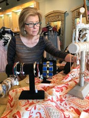 Gwen Rakestraw of Madison shops for costume jewelry at the Merle Norman studio in Madison.