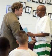 Dr. Otis Pickett, PTCPP co-founder and co-director, congratulates PTCPP Summer 2018 course graduate Dwayne O'Quinn on sharing aloud his essay on Fannie Lou Hamer's speeches.