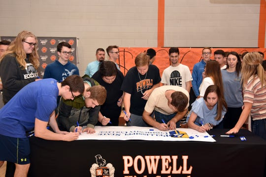 Powell High seniors signed banners in celebration of committing to a college, vocational education or military service during the school's senior signing day on May 1, 2019.