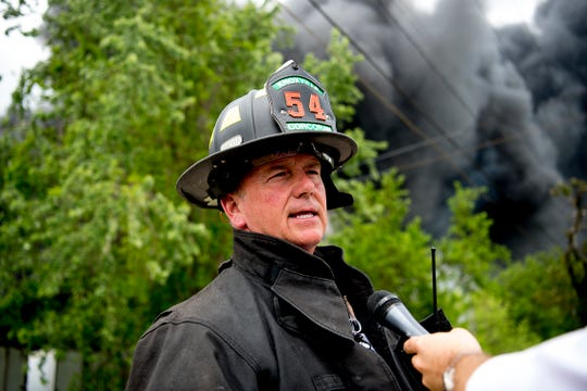 KFD spokesman DJ Corcoran speaks during a press conference at a fire at Fort Loudon Waste & Recycling in North Knoxville, Tennessee on Wednesday, May 1, 2019.