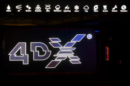 A graphic displaying the features experienced with 4DX technology is seen outside Regal's new 4DX auditorium at Knoxville's Regal Pinnacle theatre in Turkey Creek, Wednesday, May 1, 2019. The theatre will be the first in Tennessee to offer the 4DX experience.