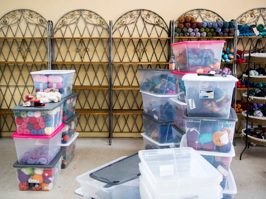 Bakers racks line the wall as yarn is stored in plastic containers at The Yarn Haven on Cedar Bluff Road in Knoxville on Wednesday, May 1, 2019.