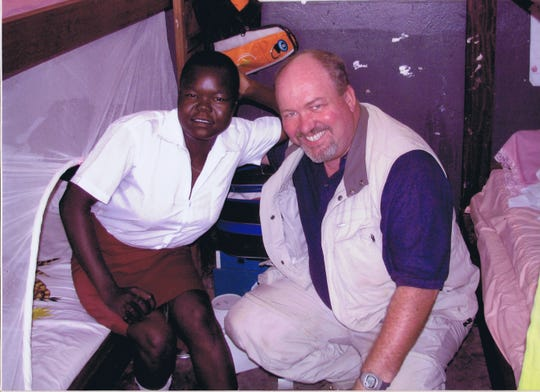Betty Asha, left, with Maryville resident Chris Hurley, right, at Yei Girls' School in May 2012. Hurley paid Asha's enrollment costs for the school so she could continue her education.