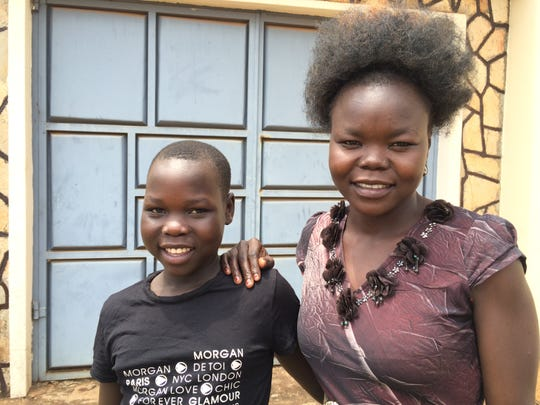 Betty Asha, right, poses with Viola, a girl from her village. With funding assistance from Maryville resident Chris Hurley, Betty rescued Viola and more than 2,000 other refugees from a South Sudanese conflict zone.