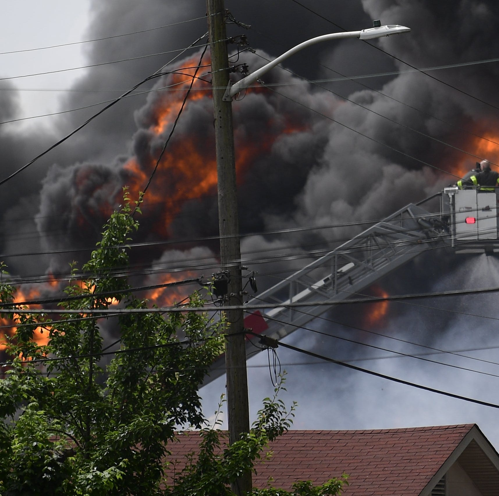 Evacuations begin as crews battle massive blaze at Fort Loudon recycling center