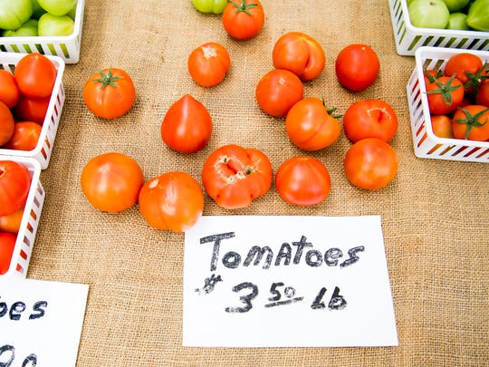 Tomatoes sold by Spring Oak Farm at the Market Square Farmers Market, which had its opening day in downtown Knoxville on Wednesday, May 1, 2019.