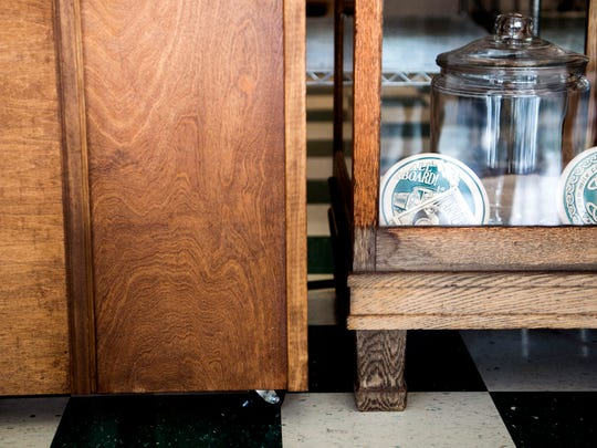 Discoloration at the bottom of a wooden display cabinet, at right, shows high how the water went inside Old Mill Bread Company's store on Cedar Bluff Road in Knoxville.