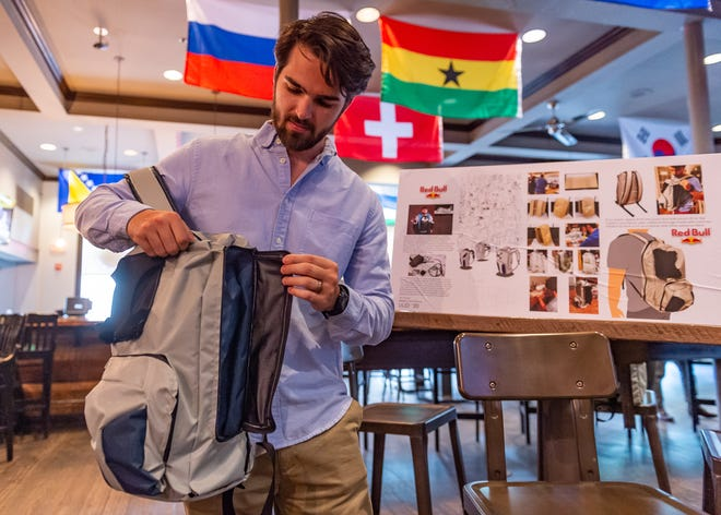 Tim Dupre demonstrates the bag he designed for the competition as UL design students spend spring semester developing streaming backpack for top e-sport athlete. Wednesday, May 1, 2019.