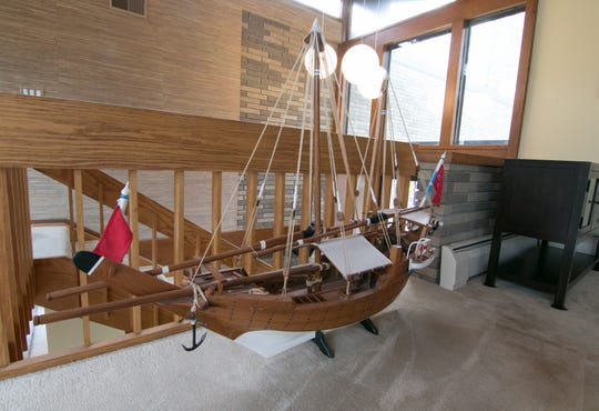 The finish of the wood on a model boat fits perfectly with the wood accents throughout a home on Nine Mile Road, shown Tuesday, April 30, 2019.
