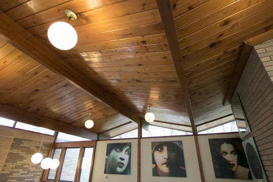 The unique roof line of a home on Nine Mile Road is reflected throughout the pine ceilings of the second level.