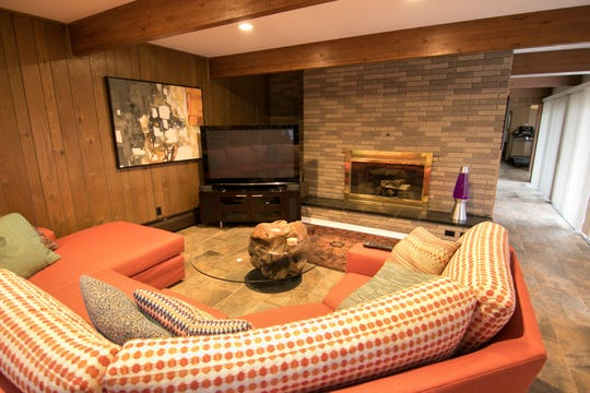 A great room on the lower level of a Nine Mile Road home, shown Tuesday, April 30, 2019, has been decorated consistent with the mid-century modern design of the home.