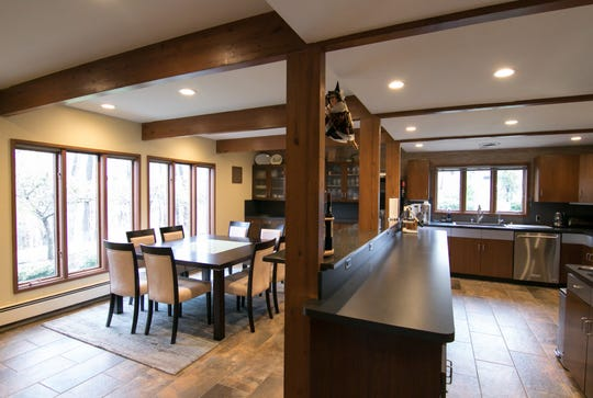 The original wooden posts, beyond their support, provide a subtle separation of the kitchen and dining room and reflect the mid-century modern look of a home on Nine Mile Road, shown Tuesday, April 30, 2019.