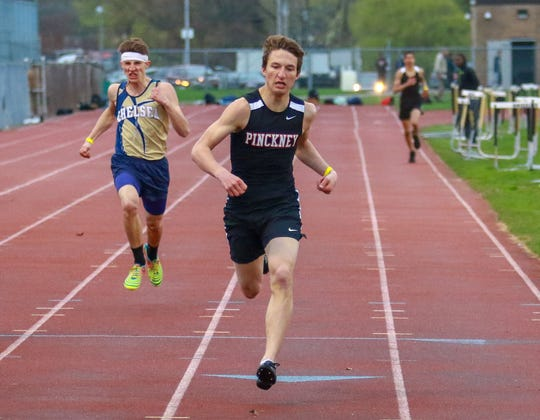 Dylan Reason of Pinckney wins the 400-meter run in a tri-meet against Chelsea and Ypsilanti on Tuesday, April 30, 2019.