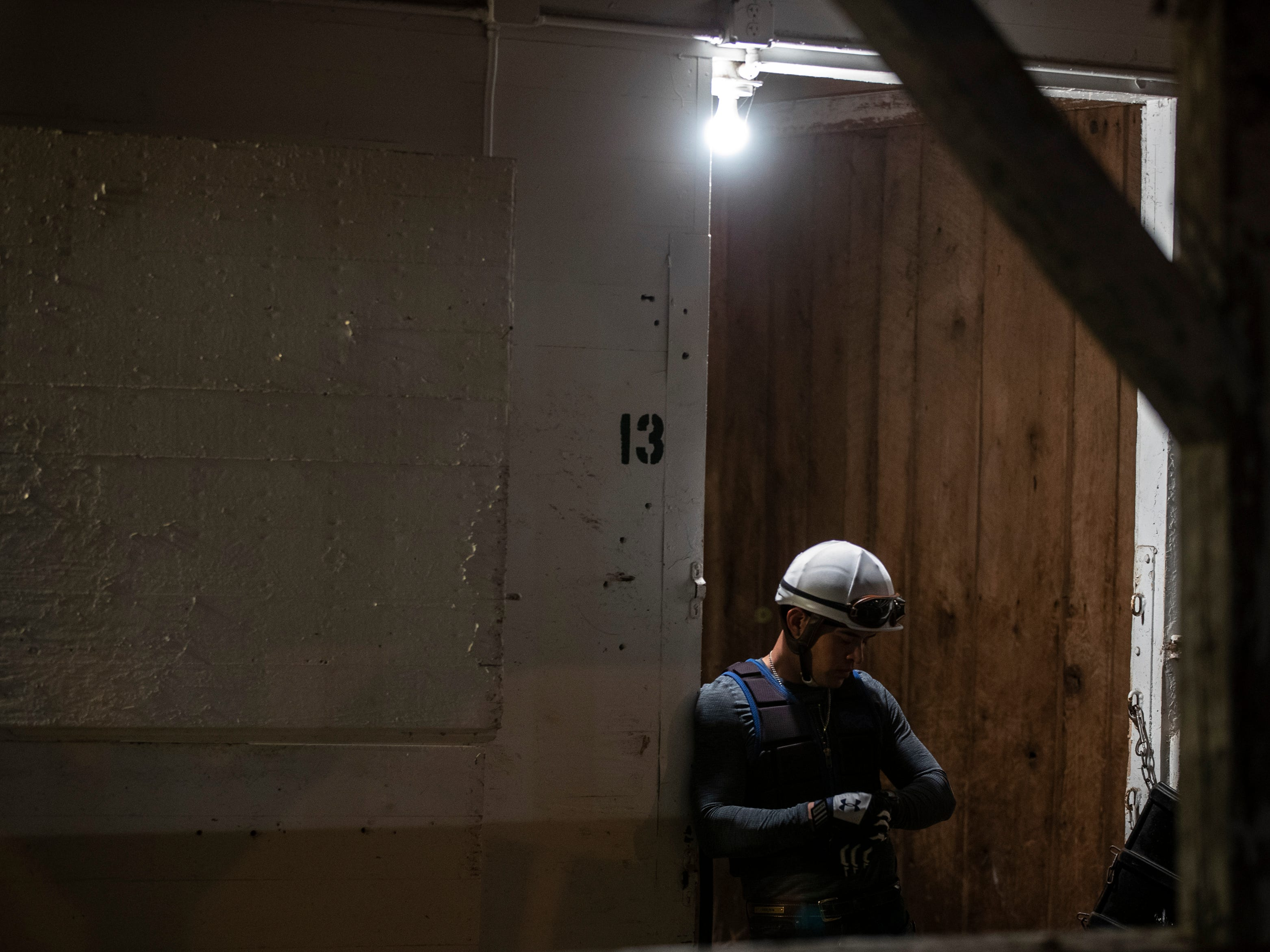 A groom checked his watch before morning workouts began at Churchill Downs. May 1, 2019.