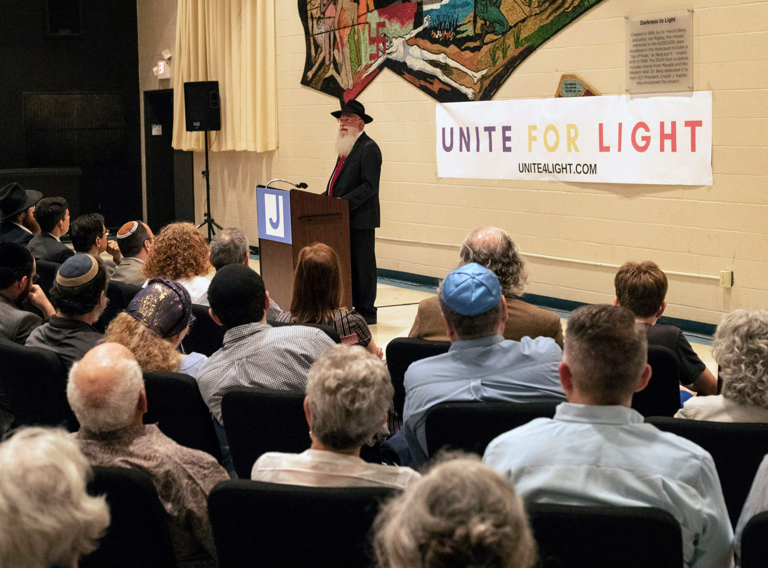 Rabbi Avrohom Litvin, regional director of Chabad Kentucky, was the final speaker at a Unite For Light service at the Jewish Community Center on Tuesday night. April 30, 2019