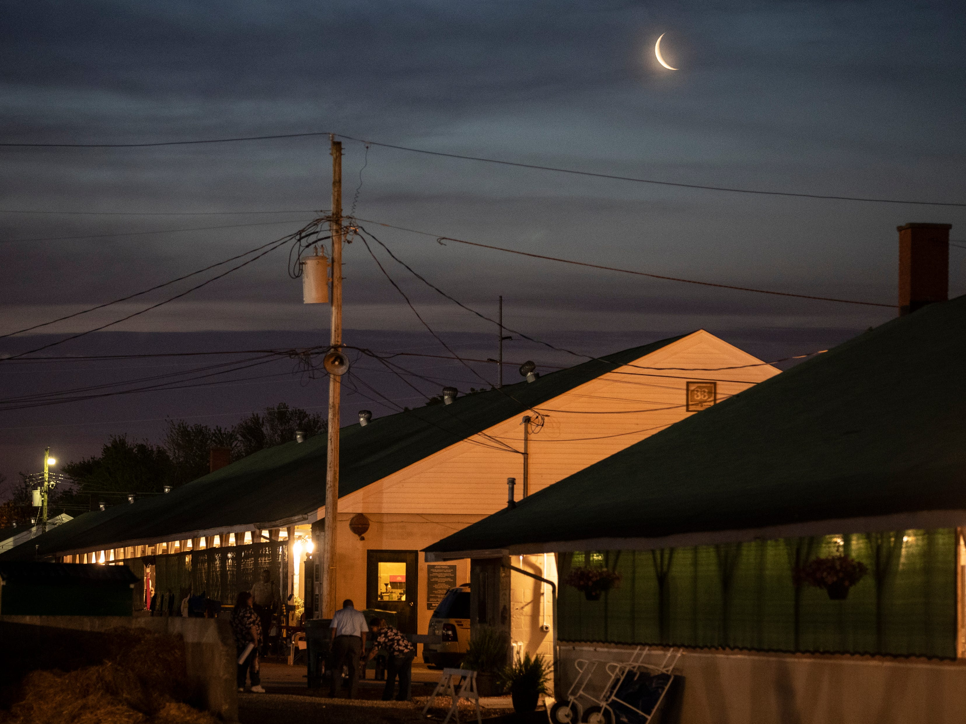 The moon rose over the barns on the backside of Churchill Downs. May 1, 2019