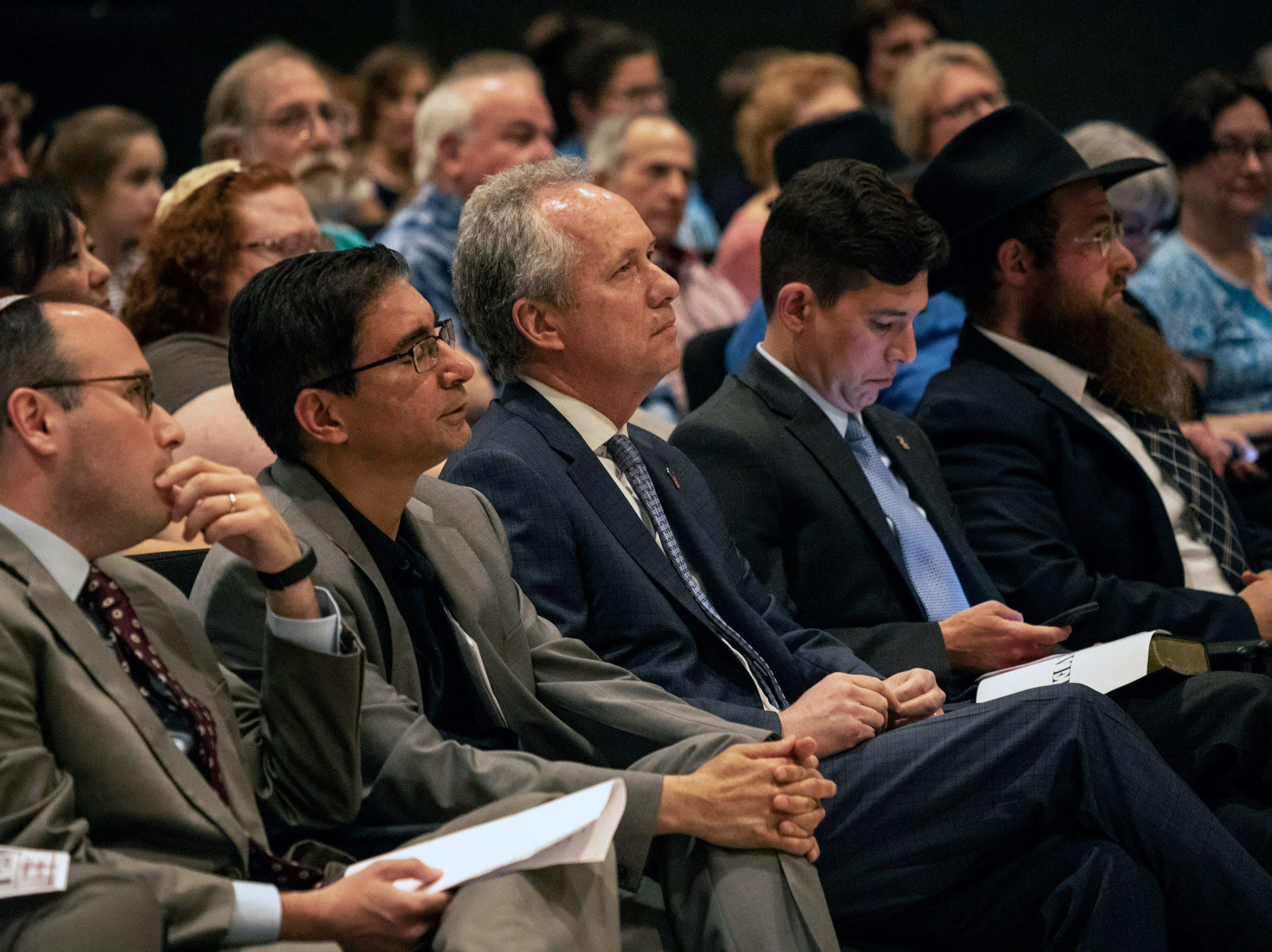 Louisville Mayor Greg Fischer sits with local faith leaders during a Unite For Light prayer service at the Jewish Community Center on Tuesday. April 30, 2019