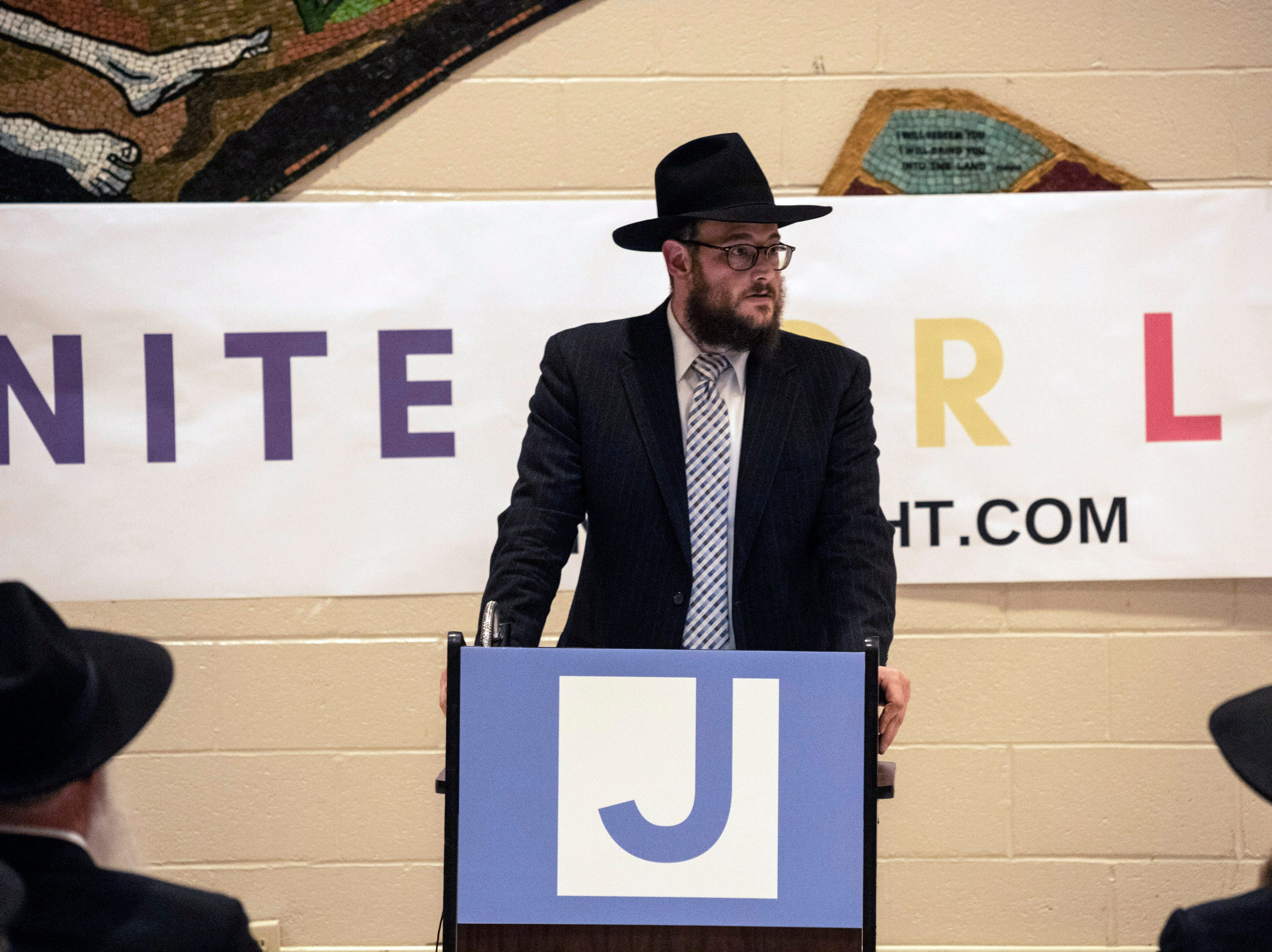 Rabbi Shmully Litvin welcomed guests to the Jewish Community Center on Tuesday night for a Unite For Light prayer service. April 30, 2019