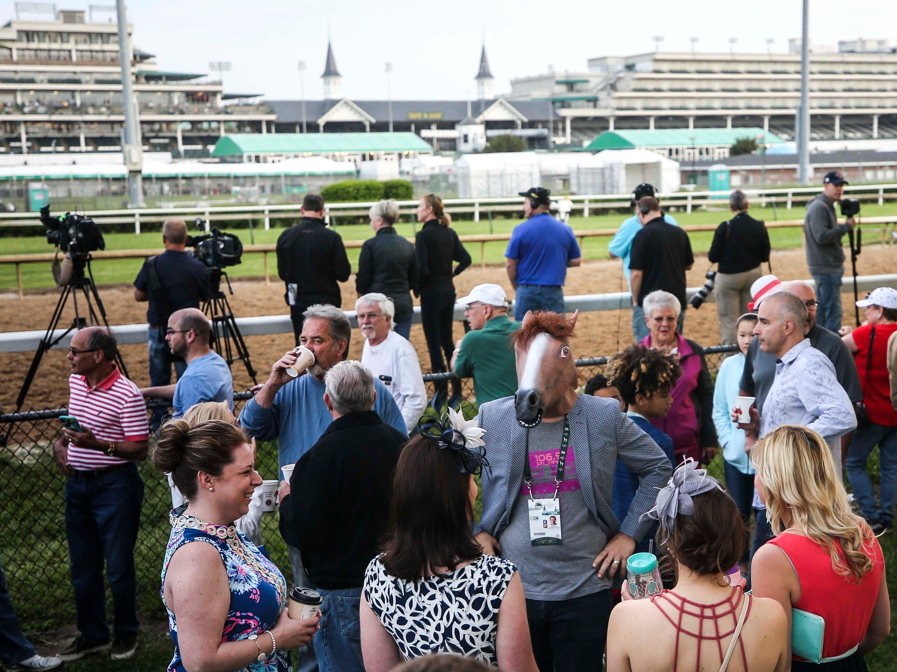 "'If you can't wear a horse mask at the backside during Derby week, where can you?"" said Jesse Rasmussen as he milled about in the Churchill Downs backside Wednesday morning before the running of the 145th Kentucky Derby. May 1, 2019"